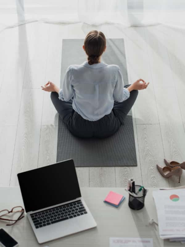 A woman practises meditation for mindfulness at work